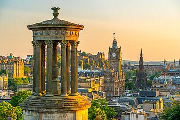 View of Edinburgh Castle, Balmoral Hotel and Dugald Stewart monument from Calton Hill at golden hour, Edinburgh, Scotland, United Kingdom, Europe