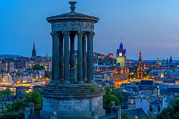 View of Edinburgh Castle, Balmoral Hotel and Dugald Stewart monument from Calton Hill at dusk, Edinburgh, Scotland, United Kingdom, Europe