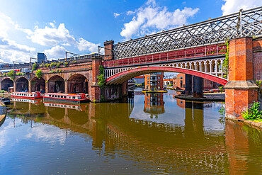 View of tram and train bridges reflecting in Castlefield Canal, Castlefield, Manchester, England, United Kingdom, Europe