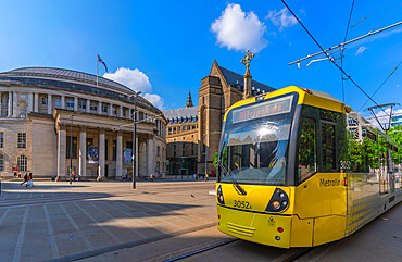 View of tram passing Central Library and monument in St Peter's Square, Manchester, Lancashire, England, United Kingdom, Europe