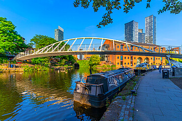 View of 301 Deansgate and walk bridge over canal, Castlefield Canal, Manchester, England, United Kingdom, Europe