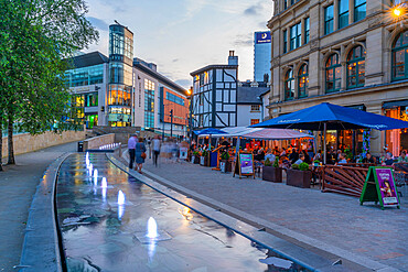 View of The Corn Echange and Oyster Bar in Exchange Square at dusk, Manchester, Lancashire, England, United Kingdom, Europe