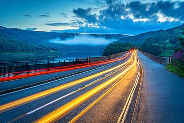 View of trail lights on Ladybower Reservoir bridge at dusk, Peak District National ParkDerbyshire, England, United Kingdom, Europe