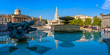 View of The National Gallery, St. Martins-in-the-Fields church and fountains in Trafalgar Square, Westminster, London, England, United Kingdom, Europe