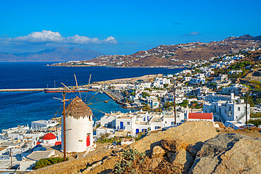 View of white washed windmill overlooking town and harbour, Mykonos Town, Mykonos, Cyclades Islands, Greek Islands, Aegean Sea, Greece, Europe