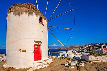 View of white washed windmill overlooking town, Mykonos Town, Mykonos, Cyclades Islands, Greek Islands, Aegean Sea, Greece, Europe