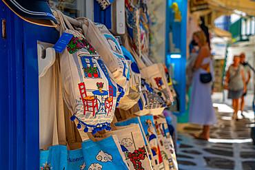 View of souvenir bags for sale in narrow street in Mykonos Town, Mykonos, Cyclades Islands, Greek Islands, Aegean Sea, Greece, Europe