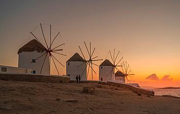 View of the windmills in Mykonos Town at sunset, Mykonos, Cyclades Islands, Greek Islands, Aegean Sea, Greece, Europe
