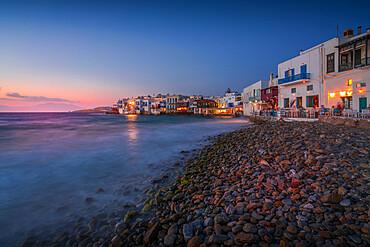 View of restauramts and pebbled beach at Little Venice in Mykonos Town at night, Mykonos, Cyclades Islands, Greek Islands, Aegean Sea, Greece, Europe