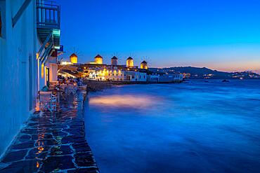 View of windmills from Little Venice in Mykonos Town at night, Mykonos, Cyclades Islands, Greek Islands, Aegean Sea, Greece, Europe