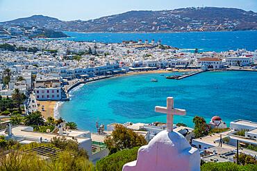 Elevated view of hilltop chapel, flour mills and town, Mykonos Town, Mykonos, Cyclades Islands, Greek Islands, Aegean Sea, Greece, Europe