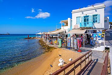 View of restaurant overlooking Old Port Beach, Mykonos Town, Mykonos, Cyclades Islands, Greek Islands, Aegean Sea, Greece, Europe