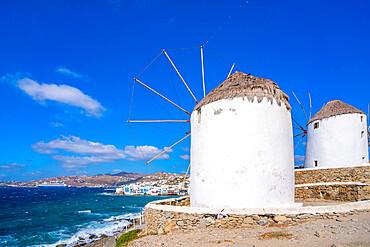 View of windmills and town in background, Mykonos Town, Mykonos, Cyclades Islands, Greek Islands, Aegean Sea, Greece, Europe