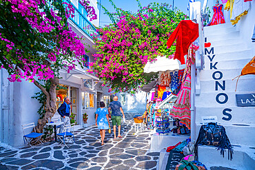 View of white washed narrow street with shops and cafes, Mykonos Town, Mykonos, Cyclades Islands, Greek Islands, Aegean Sea, Greece, Europe