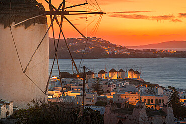 View of the windmills and town from elevated position at dusk, Mykonos Town, Mykonos, Cyclades Islands, Greek Islands, Aegean Sea, Greece, Europe