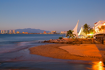View over beach ast dusk, Downtown, Puerto Vallarta, Jalisco, Mexico, North America