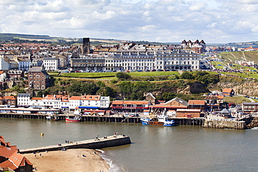 Tate Hill Pier and the West Cliff with St. Hilda's Church, Whitby, Yorkshire, England, United Kingdom, Europe