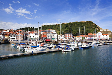 Yachts moored in the Old Harbour below Castle Hill, Scarborough, Yorkshire, England, United Kingdom, Europe