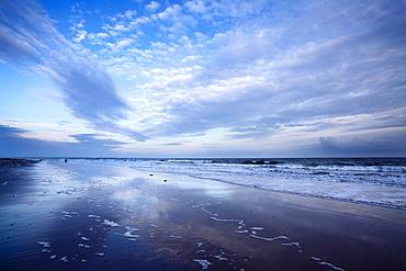 Cloud reflections at twilight on Alnmouth Beach, Northumberland, England, United Kingdom, Europe