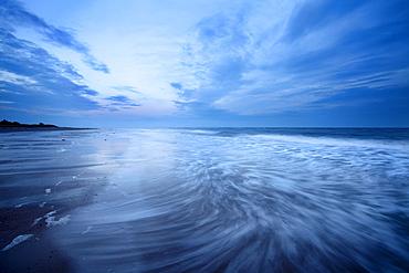 Waves at dusk on Alnmouth Beach, Northumberland, England, United Kingdom, Europe