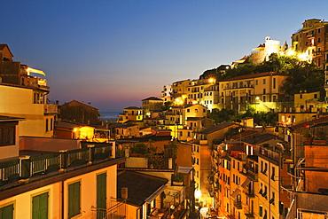 Riomaggiore rooftops and the Castle at dusk, Cinque Terre, UNESCO World Heritage Site, Liguria, Italy, Mediterranean, Europe
