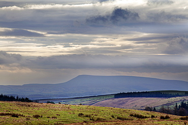 Stormy sky over Pendle Hill from above Settle, North Yorkshire, Yorkshire, England, United Kingdom, Europe