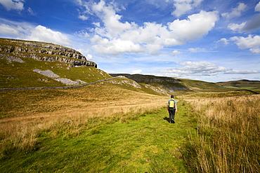Walker on a Public Footpath near Settle, Yorkshire, England, United Kingdom, Europe
