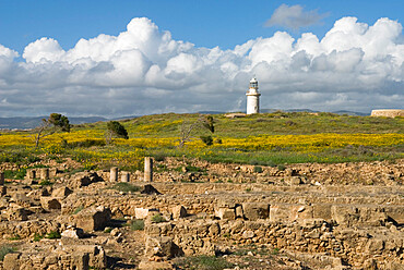 View over ruined Roman town to the lighthouse, The Agora, Archaeological Park, Paphos, UNESCO World Heritage Site, Cyprus, Europe