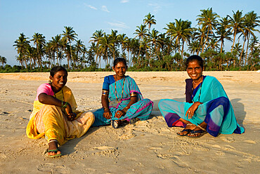 Local women on beach, Benaulim, Goa, India, Asia