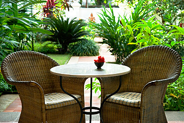 Terrace table and chairs in hotel, Kochi (Cochin), Kerala, India, Asia