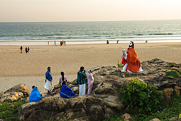 Christian worshippers in evening, Chowara Beach, near Kovalam, Kerala, India, Asia