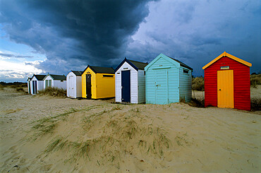 Beach huts under stormy sky, Southwold, Suffolk, England, United Kingdom, Europe