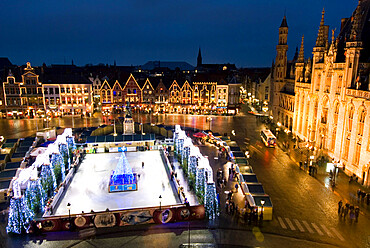 Ice Rink and Christmas Market in the Market Square, Bruges, West Vlaanderen (Flanders), Belgium, Europe