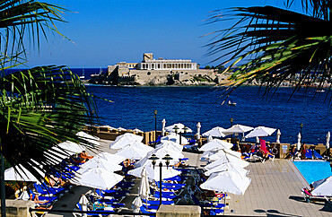 View over bay and pool area of Corinthia San Gorg Hotel, St. George`s Bay, Malta, Mediterranean, Europe