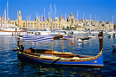 View across Dockyard Creek to Maritime Museum on Vittoriosa with traditional boat, Senglea, Malta, Mediterranean, Europe