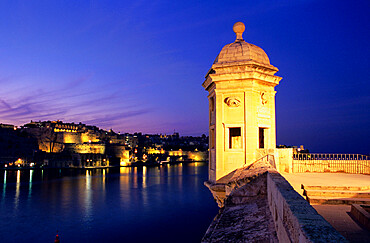 Vedette watchtower and view across the Grand Harbour to Valletta at dusk, Senglea, Malta, Mediterranean, Europe