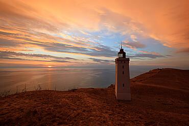 Rubjerg Knude Fyr (lighthouse) buried by sand drift at sunset, Lokken, Jutland, Denmark, Scandinavia, Europe