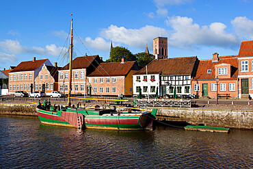 Riverfront houses and tower of Ribe Domkirke, Ribe, Jutland, Denmark, Scandinavia, Europe