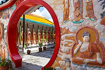 Circular doorway and Buddha's, Kek Lok Si Temple, Crane Hill, Georgetown, Pulau Penang, Malaysia, Southeast Asia, Asia