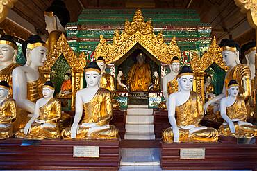 Buddha statues inside the Shwedagon pagoda, Yangon (Rangoon), Yangon Region, Myanmar (Burma), Asia