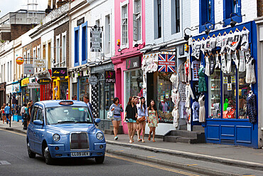 Trendy shops and taxi, Pembridge Road, Notting Hill, London, England, United Kingdom, Europe