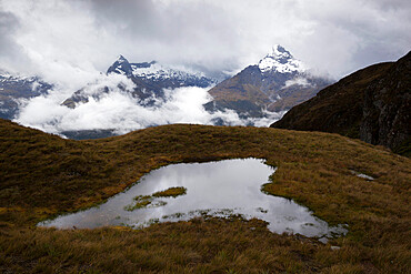 Darran Mountains and tarn from Harris Saddle, Routeburn Track, Fiordland National Park, UNESCO World Heritage Site, South Island, New Zealand, Pacific