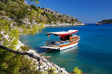 Small gulet boat in craggy cove, Kekova, near Kas, Lycia, Antalya Province, Mediterranean Coast, Southwest Turkey, Turkey, Asia Minor, Eurasia