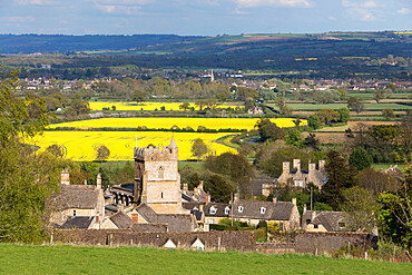 St. Lawrence church and oilseed rape fields, Bourton-on-the-Hill, Cotswolds, Gloucestershire, England, United Kingdom, Europe