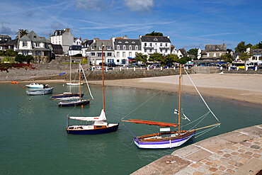 View of beach and boats in harbour, Locquirec, Finistere, Brittany, France, Europe