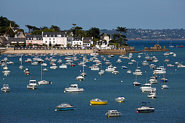 View over seaside village and boats in bay, Locquirec, Finistere, Brittany, France, Europe