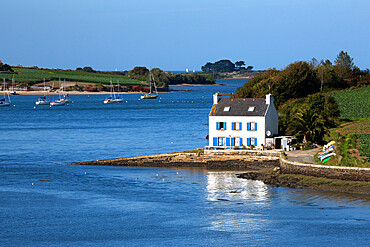Typical French cottage on Penze estuary viewed from Pont de la Corde, near Carantec, Finistere, Brittany, France, Europe
