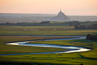 View over meandering river to Bay of Mont Saint-Michel, UNESCO World Heritage Site, from Jardin des Plantes viewpoint, Avranches, Normandy, France, Europe