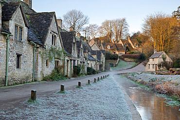 Arlington Row Cotswold stone cottages on frosty morning, Bibury, Cotswolds, Gloucestershire, England, United Kingdom, Europe