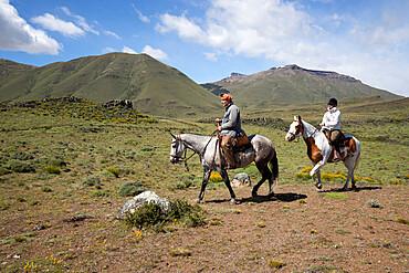 Gaucho guide and tourist on horse at Estancia Alta Vista, El Calafate, Parque Nacional Los Glaciares, UNESCO World Heritage Site, Patagonia, Argentina, South America